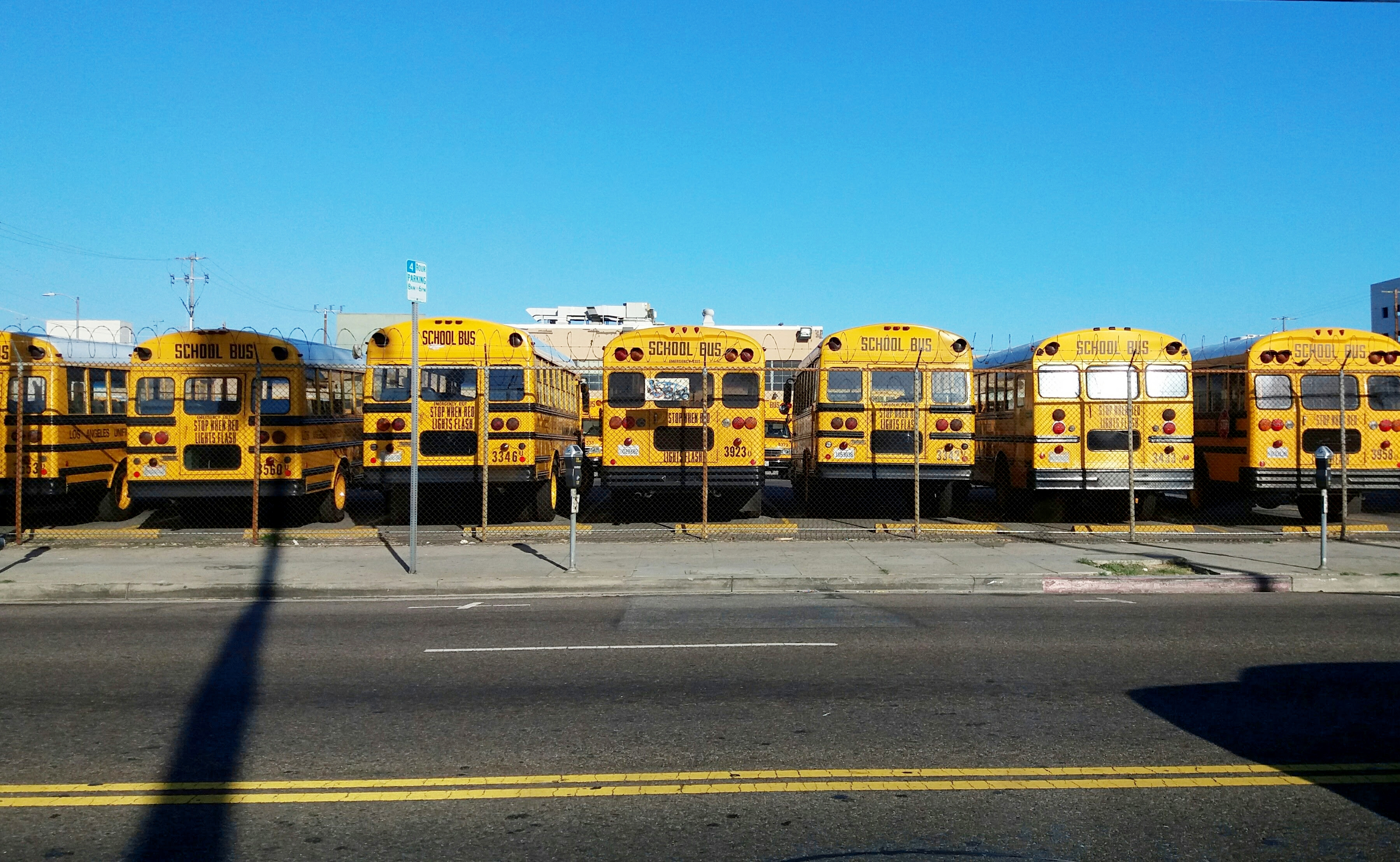 K12 stockphoto fleet of parked buses