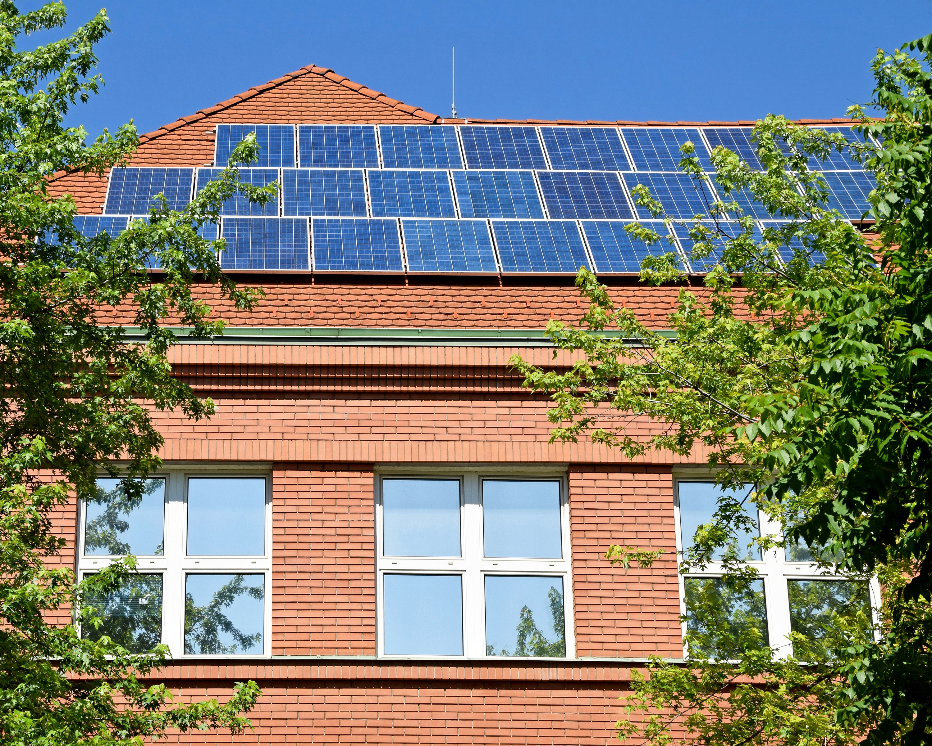 K12 stockphoto school building roof solar panels